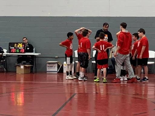 Coach Remi in the Huddle
