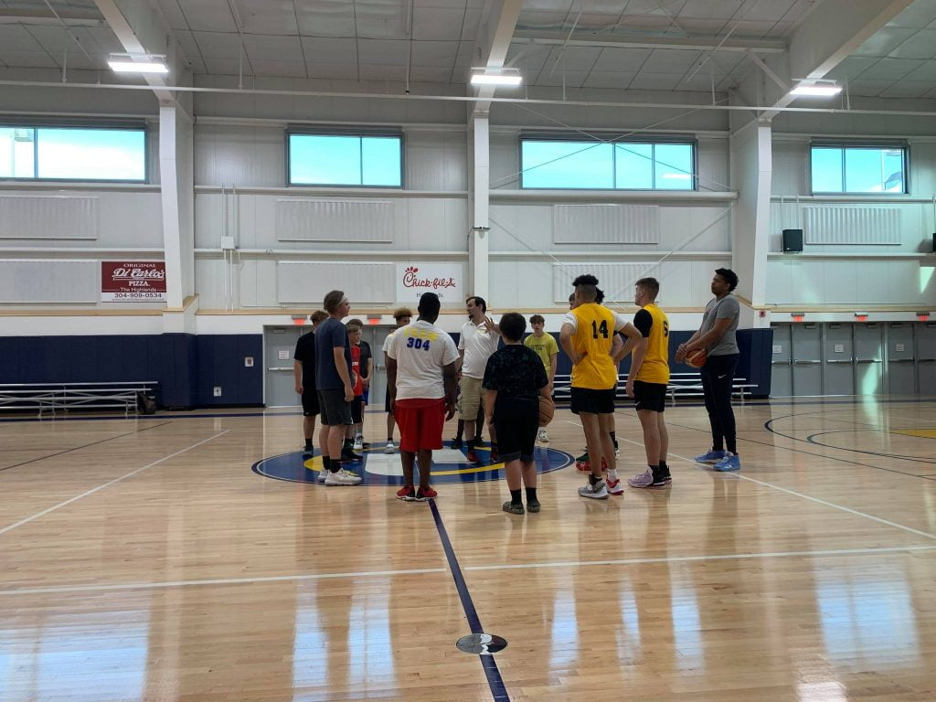 Players and coach in the huddle